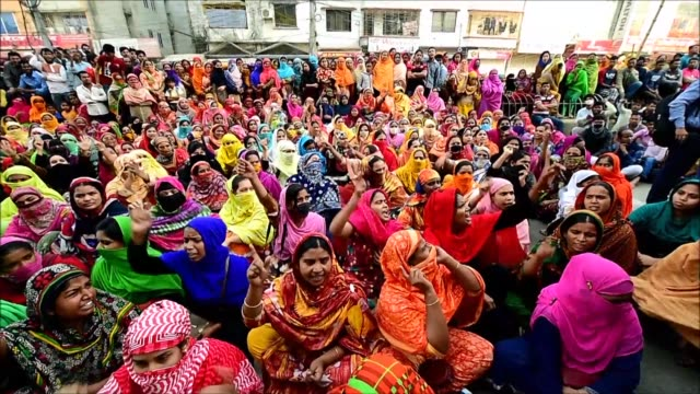 thousands of bangladeshi garment workers go on strike demanding higher wages in a fourth day of industrial action - strike industrial action stock videos & royalty-free footage