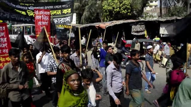 thousands of bangladeshis held emotional and violent protests on the one year anniversary of the worlds worst garment factory disaster as western... - garment stock videos & royalty-free footage