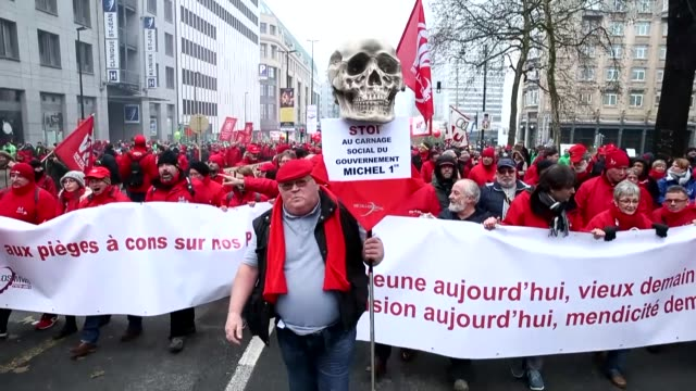 Thousands of Belgian Trade Union members march during a protest against the pension reform plans of the Belgian government in Brussels on December 19...
