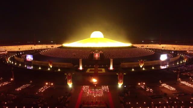 Thousands of Buddhist devotees and monks take part in evening prayers to mark Makha Bucha Day at Wat Dhammakaya temple just north of Bangkok Makha...