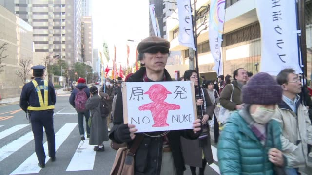 thousands of campaigners rally against nuclear power in tokyo as the government and utilities move toward resumption of reactors in southern japan... - nuclear energy stock videos & royalty-free footage