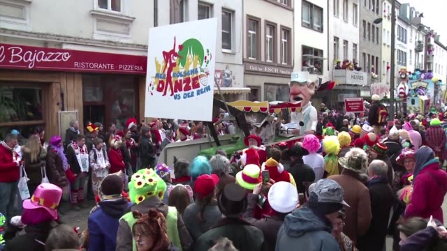 Thousands of carnival goers take to the streets of Cologne in western Germany to take part in the traditional Rose Monday parade of floats the...