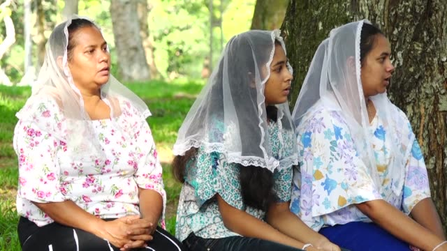 thousands of catholics attend sunday mass in sri lanka's capital colombo amid tight security aimed at preventing a repeat of the easter day bomb... - hold me tight stock videos & royalty-free footage