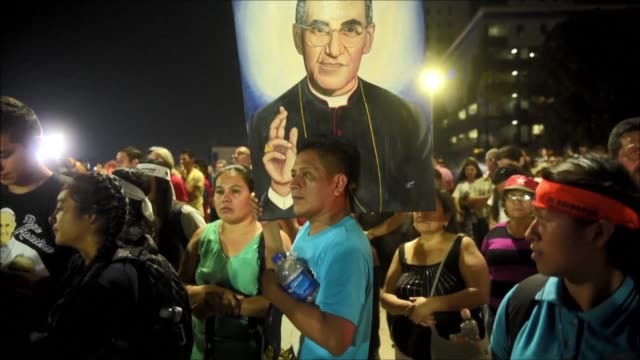 thousands of catholics hold a vigil at the salvador del mundo square in san salvador to commemorate the 37th anniversary of the death of oscar... - archbishop stock videos & royalty-free footage