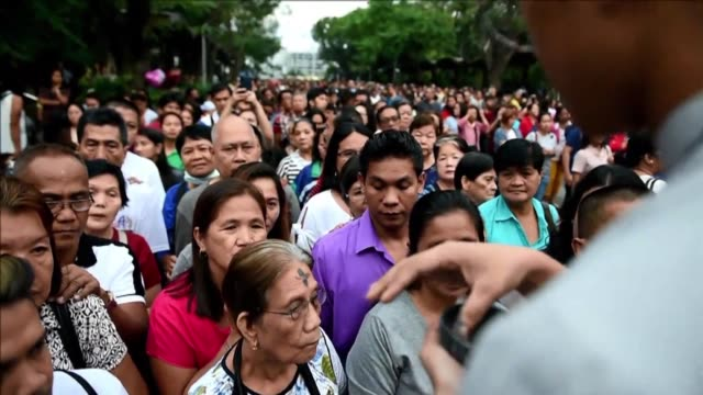 Thousands of Catholics queue on Ash Wednesday for seminarians and priests to apply ash to their foreheads marking the start of the 40 day Lent a...