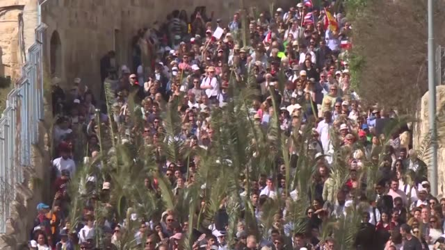 thousands of christians attend a palm sunday procession passing holy sites in jerusalem walking from the church of bethphage on mount of olives to... - easter stock videos & royalty-free footage