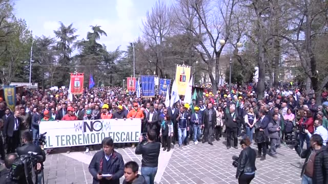 thousands of citizens, entrepreneurs and traders from l'aquila marched through the streets of the capital of abruzzo, l'aquila, on april 16, 2018 to... - financial accessory stock videos & royalty-free footage