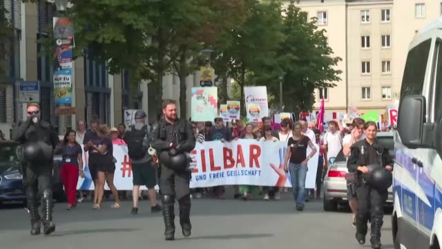 thousands of civil society activists demonstrate against hate and racism in dresden a week before state elections in which the far right party afd is... - distant stock videos & royalty-free footage