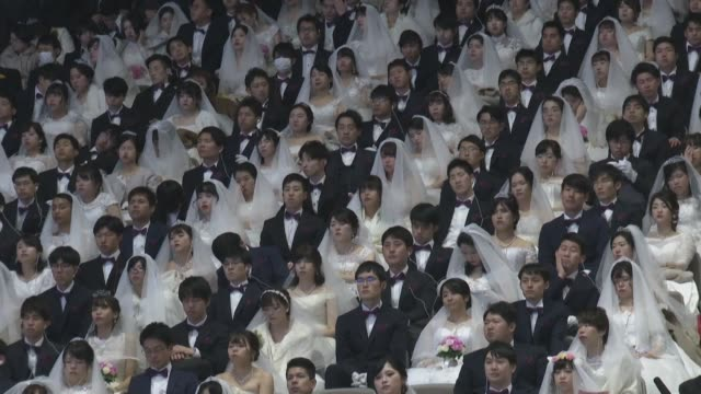 thousands of couples some in facemasks tie the knot in a mass unification church wedding, despite concerns in south korea over the spread of the... - south korea couple stock videos & royalty-free footage