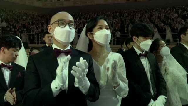 thousands of couples some in facemasks tie the knot in a mass unification church wedding despite concerns in south korea over the spread of the... - south korea couple stock videos & royalty-free footage