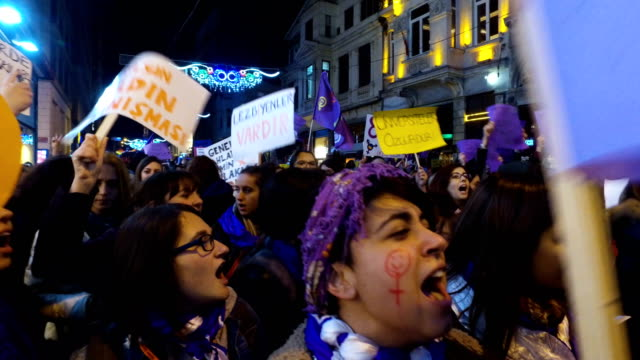 thousands of demonstrators march down istanbul's famous istiklal street during a rally for international women's day on march 8 2017 in istanbul... - internationaler frauentag stock-videos und b-roll-filmmaterial