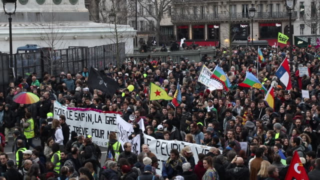 thousands of demonstrators march in the streets of downtown paris during the thirteenth day of a general strike on december 17 2019 in paris france... - バスティーユ点の映像素材/bロール