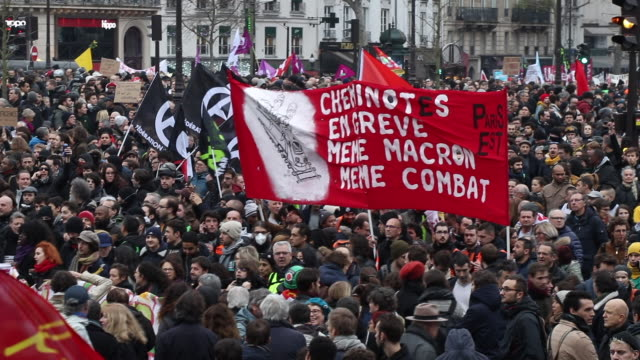 thousands of demonstrators march in the streets of downtown paris during the thirteenth day of a general strike on december 17 2019 in paris france... - bastille paris stock videos & royalty-free footage