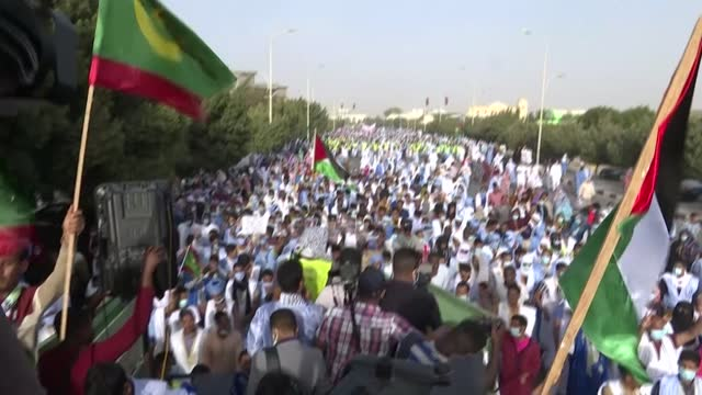 """thousands of demonstrators march in the streets of nouakchott, the capital of mauritania, to denounce """"the aggression perpetrated against the... - nouakchott stock videos & royalty-free footage"""
