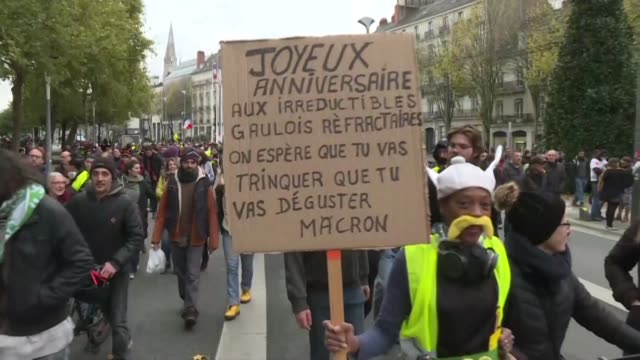 thousands of demonstrators march through nantes to mark the first anniversary of the yellow vests movement as police fire tear gas - nantes stock videos & royalty-free footage