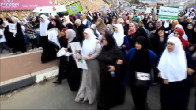 thousands of demonstrators protest banning of islamic movement in the 1948 palestine by israel by way of chanting slogans and carrying banners at umm... - chanting stock videos and b-roll footage