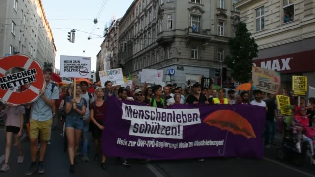 Thousands of demonstrators take a part in a protest against the Austrian government's immigration policy on the occasion of the International...