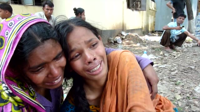 thousands of distraught relatives watched rescuers thursday battle to find their loved ones in the rubble of a collapsed bangladeshi garment factory... - bangladesh stock videos & royalty-free footage