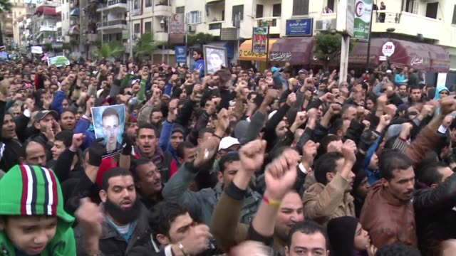 thousands of egyptians marched in the canal city of port said which was at the heart of last weeks clashes after 21 residents were sentenced to death... - port said stock videos and b-roll footage