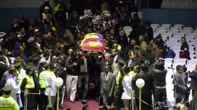 Thousands of fans filed past the coffin of Ecuadoran football hero Christian Benitez for a statesman like farewell in Quito on Friday after an...