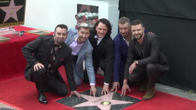 Thousands of fans shut down Hollywood's Walk of Fame as 1990s boy band NSYNC are recognized for a glittering chart run that catapulted Justin...