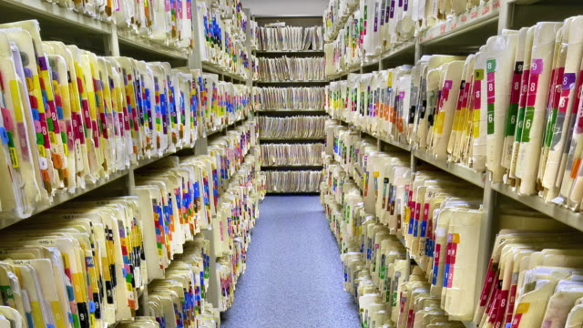 ms zo thousands of file-folders records on storage shelves / fairbanks, alaska, united states - akte stock-videos und b-roll-filmmaterial