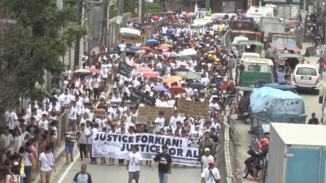 thousands of filipinos saturday called for an end to extrajudicial killings as the funeral of a boy killed by police turned into the largest single... - brutal killing stock videos & royalty-free footage