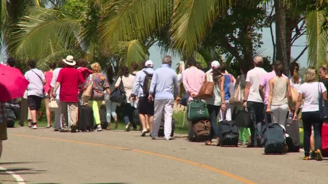 thousands of frustrated tourists lined up under sweltering heat wednesday to board airlifts out of the flooded resort of acapulco while a drenched... - drenched stock videos & royalty-free footage