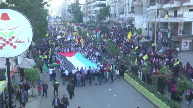 thousands of hezbollah supporters take part in a rally to protest us recognition of jerusalem as the israeli capital on december 11 2017 of beirut... - hezbollah stock videos & royalty-free footage