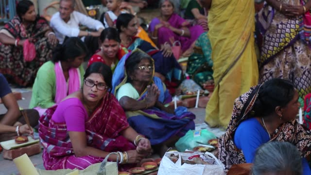 thousands of hindu devotees sit with prodip and pray to god in front of shri shri lokanath brahmachari ashram temple during the religious festival... - religious saint stock videos and b-roll footage