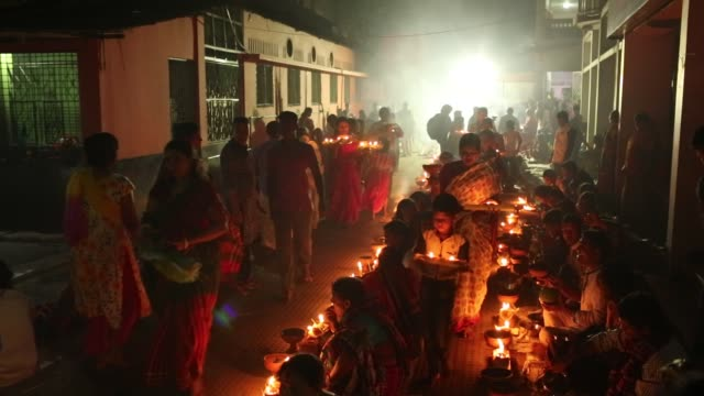 Thousands of Hindu devotees sit with Prodip and pray to God in front of Shri Shri Lokanath Brahmachari Ashram temple during the religious festival...