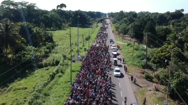 thousands of honduran migrants whose journey toward the united states has triggered a series of tirades from donald trump resume their long march... - exile stock videos & royalty-free footage