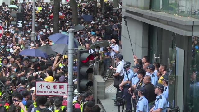 thousands of hong kong protesters gather at the city's police headquarters in wan chai calling on the city's pro beijing leader to resign and for the... - wanchai stock videos and b-roll footage