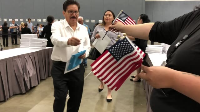 thousands of immigrants become uscitizens at a naturalization ceremony on july 25 2018 in los angeles california two naturalization ceremonies held... - citizenship stock videos & royalty-free footage