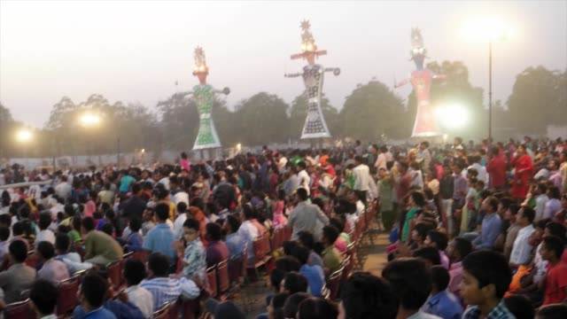 thousands of indian people young and old eagerly waiting at the mela grounds for the burning of 3 gigantic effigies dussehra is one of the most... - dashahara stock-videos und b-roll-filmmaterial