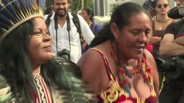 thousands of indigenous people decorated with traditional feathers and body paint converge on brazil's capital to defend hard won land rights many... - body paint stock videos & royalty-free footage