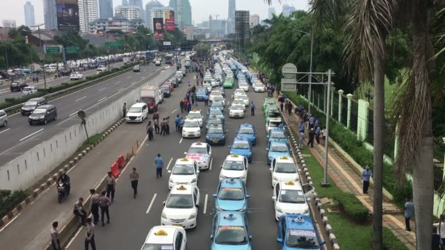 thousands of indonesian taxi and motorised rickshaw drivers block major roads in the capital jakarta and rally outside parliament in a protest... - rickshaw stock videos and b-roll footage