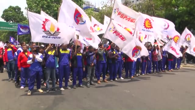 thousands of indonesian workers stage a mass protest against job cuts and outsourcing in front of the presidential palace on september 01 2015 in... - outsourcing stock videos & royalty-free footage