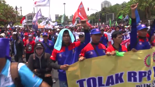 thousands of indonesian workers stage a rally to protest low wages and outsourcing in jakarta indonesia on october 15 2015 footage by adem... - outsourcing video stock e b–roll