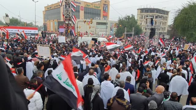 thousands of iraqis demonstrate in the heart of baghdad on january 24 2020 to demand the ouster of us troops from the country thousands of iraqis... - muqtada al sadr stock videos & royalty-free footage