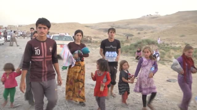 thousands of iraqis flee from the town of sinjar near the city of mosul to erbil and dohuk after armed groups affiliated with the islamic state of... - sinjar stock videos & royalty-free footage