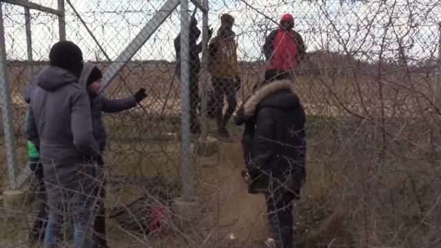 thousands of irregular migrants waiting in front of the pazarkule border crossing with greece, edirne province on february 29, 2020. migrants have... - istanbul province stock videos & royalty-free footage