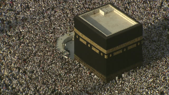 Thousands of Islam pilgrims surge around the Kaaba in Mecca.