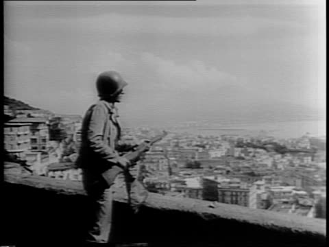 stockvideo's en b-roll-footage met thousands of italians celebrate and cheer in the streets, surround vehicle with camera passing through / pan of naples cityscape / american soldier... - omgeven