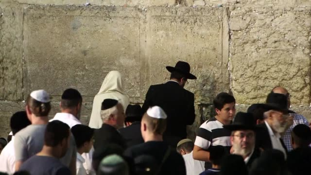 thousands of jews attend prayers at the western wall in jerusalem to observe the start of the tisha b'av fasting day days after violence shook the... - fasting activity stock videos & royalty-free footage