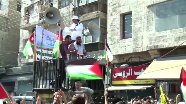 thousands of jordanians took to the streets friday calling on the government to scrap its peace treaty with israel which they accuse of violations in... - compounding stock videos and b-roll footage