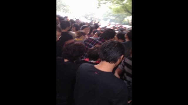 stockvideo's en b-roll-footage met thousands of locals protest in front of a government building over the construction of a chemical plant in zhejiang province's ningbo city. clean :... - ningbo