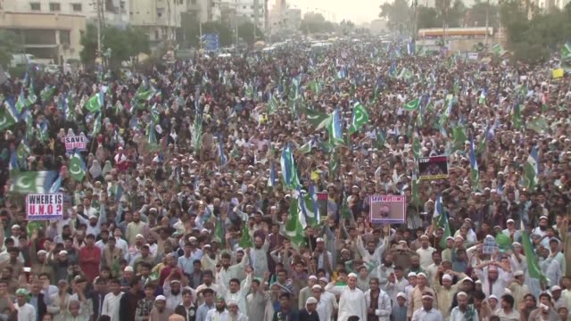 thousands of members of the religious jamaat e islami party rally in karachi to express solidarity with muslims suffering around the world including... - karachi stock videos and b-roll footage