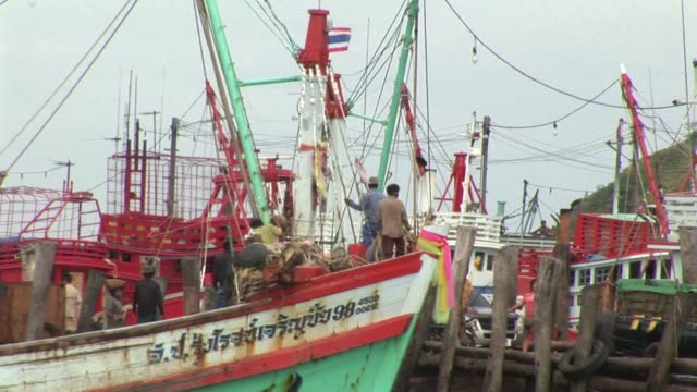 thousands of men from cambodia and myanmar also known as burma set sail on thai fishing boats every day in search of fresh catch rayong thailand - slavery stock videos & royalty-free footage