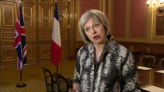 thousands of migrants storm eurotunnel terminal in calais england london home offiice int theresa may mp interview sot we've agreed today to work... - theresa may stock-videos und b-roll-filmmaterial